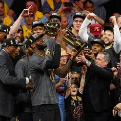 LeBron James (23) of the Cleveland Cavaliers holds the Championship Trophy after defeating the Golden State Warriors 93-89 in Game 7 of the 2016 NBA Finals.