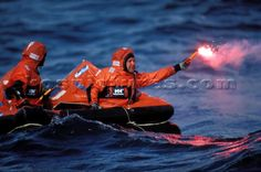 Image from http://www.kospictures.com/ImageThumbs/5-7491/3/5-7491_Two_crew_in_red_survival_suits_in_a_life_raft_holding_flare_awaiting_rescue.jpg.