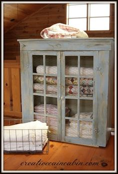 Beautiful quilt storage. Chicken wire instead of glass for cabinet
