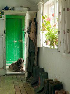 brick floor mudroom. bright back door.