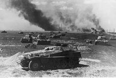 German armored vehicles on the burning fields of Słuck Russia. 1941.