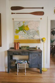 Homestead Seattle, map and oars. Love the blue desk. such a great theme for an office or  something