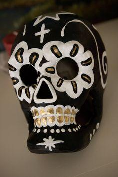 paint paper mache  skulls for dia de los muertos