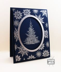 handmade card ... Silver Christmas Tree ... navy blue with silver embossing .... oval window with tree ... background filled with snowflakes ... GinaK ... luv it!