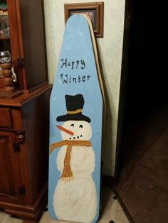 Snowman sign painted onto ironing board replica. Used reclaimed Poplar fence board.