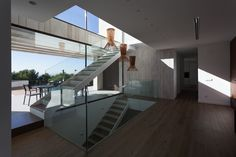 Captivating Empty Space Inside Monasterios Residence Involved Wooden Ladder Near Glass Railing Installed On Wooden Floor