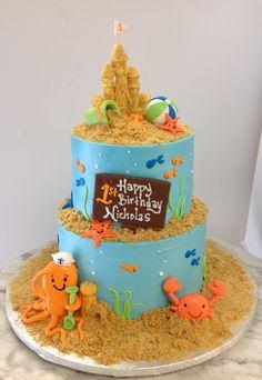 Fun sandcastle beach theme cake