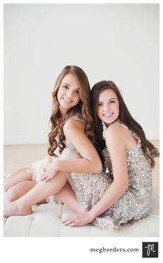 Senior friends or sisters pose
