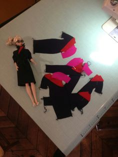 Barbie trying on uniforms. Collection of Qantas Crew Uniforms Over the Decades as Created by Former Crew Member John Willmott-Potts/Qantas