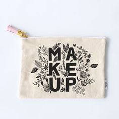 Hide your bauble bag no more. Distinctively unique with a cute, pink leather tassel and golden zipper to seal the deal, you're going to want your newest accessory in plain view. Lettered, illustrated