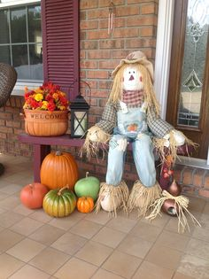 More outdoor fall decor with scarecrow!