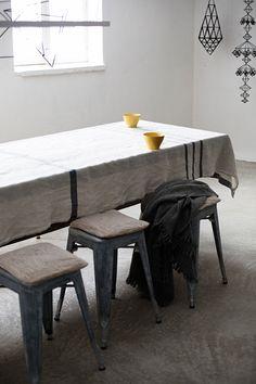 USVA tablecloth in 100% washed linen, design Anu Leinonen.CORONA UNI throw in 100% wool. Both woven in Finland by Lapuan Kankurit