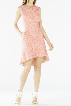 Elevate your cocktail attire in this zip-front lace dress with a subtle flared hem.    Round neckline.  Sleeveless.  Flounce hem.  Center front zipper closure.  Allover floral scroll burnout lace.  High-low hemline.  Hits above the knee.  Self: Cotton, Polyester mesh.  Lining: Polyester, Spandex.  Washable.  Imported. Chrystal Zip-Front Dress by BCBG Max Azria. Clothing - Dresses - Lace Clothing - Dresses Ohio