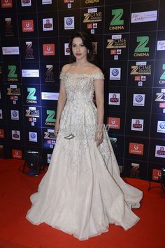 Gauahar Khan looked just like a princess out of a Disney movie as she wore an off-shoulder gown from the Lebanese label, Rony El Areif Couture for the award show. She looked just perfect that evening. Indian Evening Gown, Evening Gowns, Bollywood Celebrities, Bollywood Fashion, Indian Gowns Dresses, Prom Dresses, Gauhar Khan, Off Shoulder Gown, Indian Designer Wear