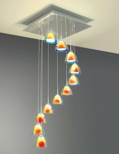A cascade of beautiful, hand-blown glass pendants make up the Rain I chandelier from Bruck Lighting. TM 3309. www.brucklighting.com