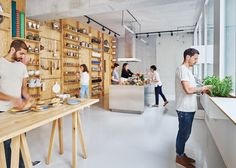 Tools and furniture hook onto a plywood wall in Paris cookery classroom by Septembre.