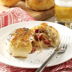 Kielbasa and sauerkraut star in a tasty filling for these scrumptious stuffed rolls, which make a great dinner with soup or salad. My family also loves leftover bundles right out of the refrigerator for a quick lunch. Sausage Recipes, Pork Recipes, Great Recipes, Cooking Recipes, Favorite Recipes, Onion Recipes, Sandwich Recipes, Fall Recipes, Yummy Recipes