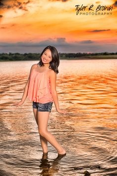 Cora stands in Lake Lewisville with a lovely sunset on the horizon.