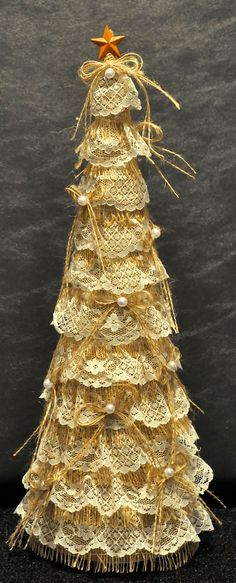 Shabby Chic Christmas tree on recycled wine bottle base, cardboard cone, covered with burlap and vintage lace.