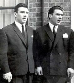 The Krays (twins, Ronnie and Reggie) 2 British killers. a movie called The Krays, was released, in the 80's with Jeremy Irons playing both parts.