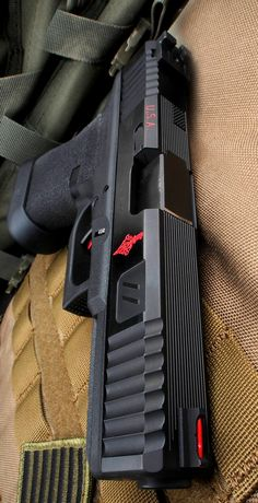 Zev modified Glock 17 with Flag engraving. - http://www.RGrips.com