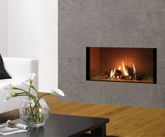 Log effect gas fire Frameless or choice of surrounds Sequential remote control NG or LPG Balanced flue (no chimney required) Manufactured by Gazco Shown: Riva 2 1050 log effect balanced flue gas fire