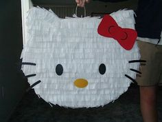 Hello Kitty Pinata - cut out shape out of cardboard, fill with candy, tape.  Cover in crepe paper.  Done! and like OMG! get some yourself some pawtastic adorable cat apparel!