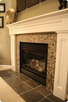 Simple slate mosaic fireplace surround.