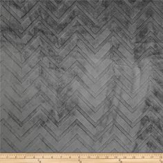 """Minky Cuddle Embossed Chevron Charcoal from @fabricdotcom  This soft and cuddly fabric features an embossed chevron design. A two-tone color is depicted by the embossed design. The fabric is dyed a solid color with a """"high/low"""" pile. The design runs the width of the fabric, has a 5 mm pile, 450 grams, and is perfect for baby accessories, blankets, throws, pillows and stuffed animals."""