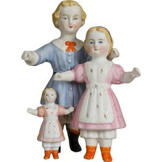 Set of Three Parian Quality Frozen Charlottes This set of fine quality dolls were made in Germany circa 1870. These three little dolls are one-piece
