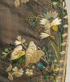 Detail embroidery, court coat, France, third quarter 18th century. Blue silk, embroidered with naturalistic flowers in coloured silk.