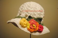 Free Pattern Easter Crochet Hat in White with Spring Rosettes