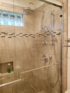 Tiled shower remodel with accent border.