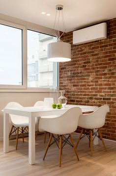 #exposed_brick_wall, white_table and #white_chairs #dining_room