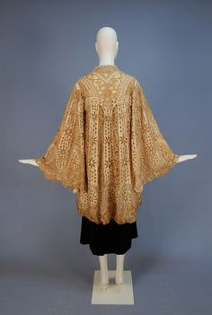 PAQUIN CUTWORK SILK and LACE EVENING COAT, c. 1905. Cream silk satin with cutwork having brown embroidery and silk cord lace, with wide bell sleeve, scalloped hem and net insertion, silk charmeuse lining.