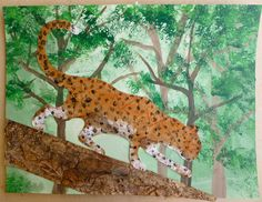 "Ms. Maggie Mo's group collage project: student drew the leopard, which was enlarged on copier and traced onto poster board. Background was painted with acrylics, sponge painted leaves. Tree was cut from corrugated cardboard and collaged with wrinkled paper bags & painted with watercolors. Leopard was collaged with brown paper bags, then painted with a watercolor wash, sponged white paint, then students used pinkie fingers to apply spots. 18"" x 24"" finished size."