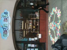Fun day doing sidewalk paint. Great way to decorate our storefront :}