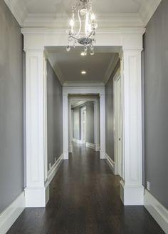LOVE!!!!!       Lane Myers Construction Custom Home Builder Loeffler Residence Draper Utah Versailles Inspired Hallway Hardwood Floors Dark Gray Walls White Trim