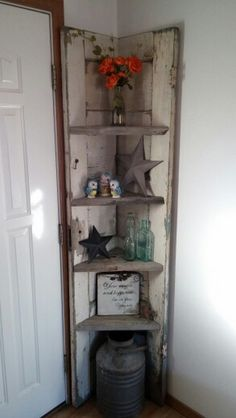 Corner shelf made from barn wood and an old door. Door Corner Shelves, Rustic Corner Shelf, Diy Corner Shelf, Corner Door, Wall Shelves, Barn Board Projects, Old Door Projects, Diy Projects, Barn Wood Crafts