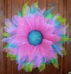 Deco Mesh Flower Wreath I sell all my handmade wreaths on Ebay & Etsy. If you're interested here's a link: https://www.etsy.com/shop/CraftingFaerie