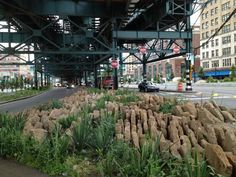 """32,145 sf (803 tons) of concrete were reused for median """"No-Go"""" barriers that directs pedestrians and bicyclists toward safe passage through the new crosswalk and bike path system but still allow for stormwater infiltration - Dutch Kills Green 