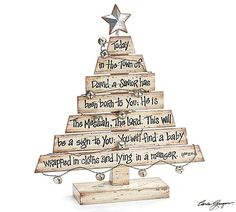 Hand-painted wood plank Christmas tree with Christmas Story printed on the planks. A distressed metal star on spring at top of tree. Wire with bells attached an
