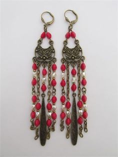 These beautiful earrings are handmade by me with 4mm cream pearl Czech glass Fire-polished beads, 5mm Czech glass pinch beads in opaque red, antiqued bronze tone chandelier link components, chain, bronze colored seed beads  long teardrop charms.   They measure 4-3/8 long which includes the plated leverback earwires.