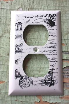 Paris Themed White Electrical Outlet Plate Cover with Hand Stamped French Script. $5.00, via Etsy.