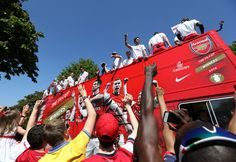 The Arsenal FC players celebrate on their bus during the Arsenal FA Cup Victory Parade in Islington, London. (18 May 2014)