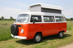 """Orange pop-up VW Camper Van Our version of the """"mini van"""" when I was a kid. I've always wanted to restore one for my family."""