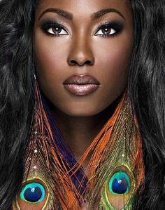 Beautiful makeup for black women - The peacock earrings are just a plus!