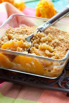 Baked Juicy Peach Crisp Recipe - Fresh peaches and almond extract with a flour and brown sugar and cinnamon crumble