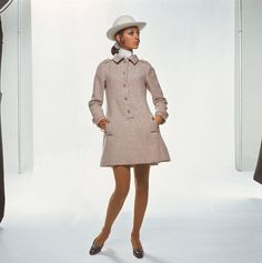 https://flic.kr/p/bpVuAR | 1968 | Marisa Berenson is wearing a heather-colored mini-shirtdress with a hat by Adolfo.   Image by © Condé Nast Archive/Corbis