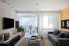 Este apartamento pequeno possui uma decoração moderna e super aconchegante. O projeto do Studio ro+ca explora o cimento queimando e o charme dos tijolinhos